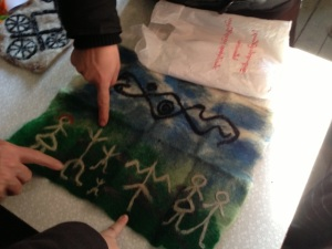Participants share the symbols in the felt they made in the workshop